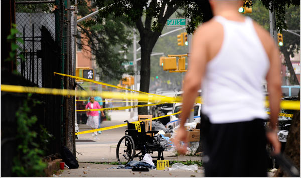 A murder scene at Gates Avenue and Patchen Avenue in Bedford-Styuvesant, Brooklyn, in July 2008. Robert Stolarik for The New York Times.